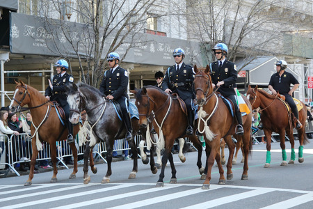 st  patrick s day: NEW YORK - MARCH 17, 2016: The United States Park Police Horse Mounted Unit participate at the St. Patrick s Day Parade in New York.