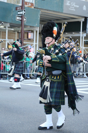 st  patrick s day: NEW YORK - MARCH 17, 2016: Bagpiper marching at the St. Patrick s Day Parade in New York.