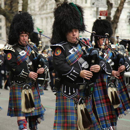 st  patrick s day: NEW YORK - MARCH 17, 2016: Bagpipers of Nassau Police Pipes and Drums marching at the St. Patrick s Day Parade in New York.