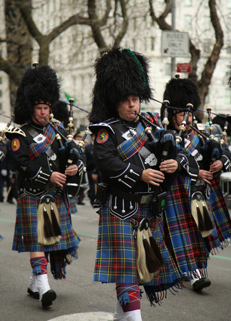st  patrick s: NEW YORK - MARCH 17, 2016: Bagpipers of Nassau Police Pipes and Drums marching at the St. Patrick s Day Parade in New York.