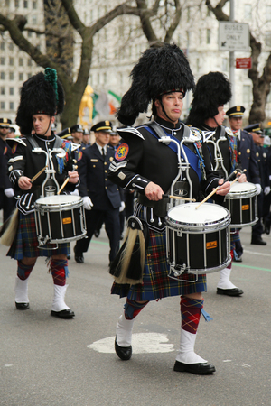 st  patrick s day: NEW YORK - MARCH 17, 2016: Drummers of Nassau Police Pipes and Drums marching at the St. Patrick s Day Parade in New York. Editorial