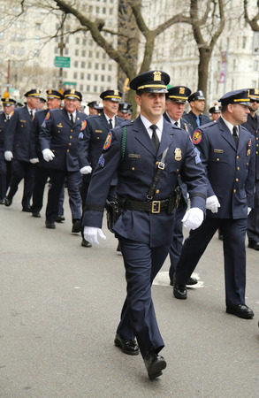 st  patrick s day: NEW YORK - MARCH 17, 2016: Nassau County Police officers marching at the St. Patrick s Day Parade in New York.
