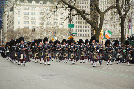 st  patrick s day: NEW YORK - MARCH 17, 2016: Nassau Police Pipes and Drums marching at the St. Patrick s Day Parade in New York. Editorial