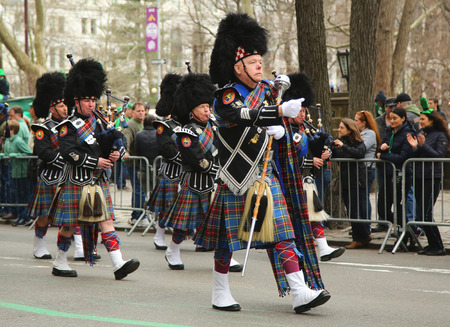 st  patrick s: NEW YORK - MARCH 17, 2016: Nassau Police Pipes and Drums marching at the St. Patrick s Day Parade in New York. Editorial