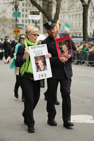 st  patrick s day: NEW YORK - MARCH 17, 2016: Families of the fallen FDNY firefighters who lost life at World Trade Center on September 11, 2001 marching at the St. Patrick s Day Parade in New York.