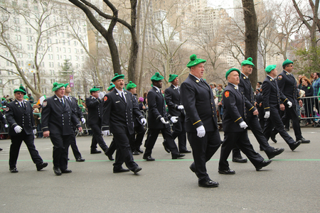 st  patrick s day: NEW YORK - MARCH 17, 2016: Fire Department of New York firefighters marching at the St. Patrick s Day Parade in New York.