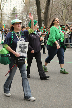 NEW YORK - MARCH 17, 2016: Families of the fallen FDNY firefighters who lost life at World Trade Center on September 11, 2001 marching at the St. Patrick s Day Parade in New York.