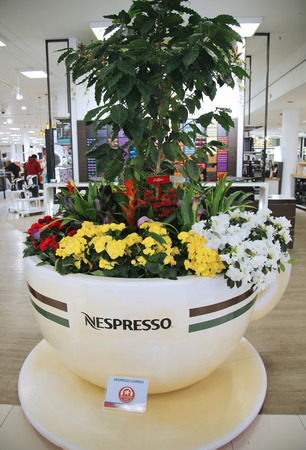 show garden: NEW YORK - MARCH 22, 2016: Nespresso Garden flower decoration during famous Macy s Annual Flower Show in the Macy s Herald Square in midtown Manhattan Editorial