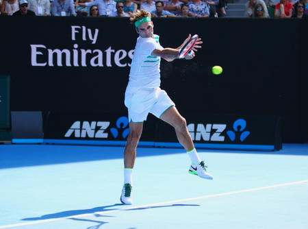 swiss ball: MELBOURNE, AUSTRALIA - JANUARY 26, 2016: Seventeen times Grand Slam champion Roger Federer of Switzerland in action during quarterfinal match at Australian Open 2016 in Melbourne Park