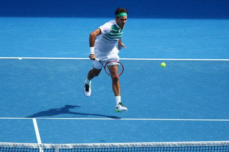 grand slam: MELBOURNE, AUSTRALIA - JANUARY 26, 2016: Seventeen times Grand Slam champion Roger Federer of Switzerland in action during quarterfinal match at Australian Open 2016 in Melbourne Park