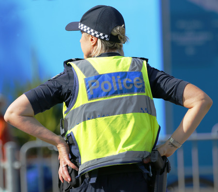 constable: MELBOURNE, AUSTRALIA - JANUARY 23, 2016: Victoria Police Constable providing security at Olympic Park in Melbourne during Australian Open 2016 Editorial