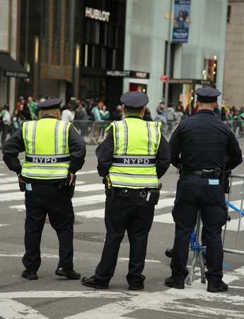 st  patrick s day: NEW YORK - MARCH 17, 2016: NYPD Officers providing security during St. Patrick s Day Parade in Midtown Manhattan