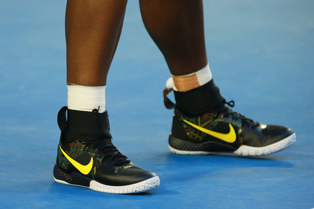 williams: MELBOURNE, AUSTRALIA - JANUARY 30, 2016: Twenty one times Grand Slam champion Serena Williams  wears custom Nike tennis shoes  during her final match at Australian Open 2016 in Melbourne Park
