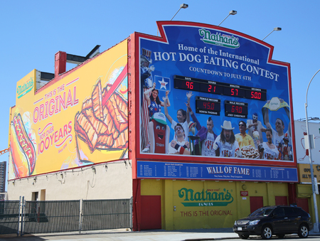 famous industries: BROOKLYN, NEW YORK - MARCH 29, 2016: The Nathan s hot dog eating contest Wall of Fame at Coney Island, New York. The original Nathan s still exists on the same site that it did in 1916 Editorial