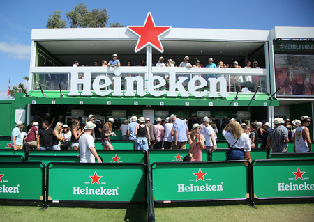 20 23 years: MELBOURNE, AUSTRALIA - JANUARY 23, 2016: Heineken Beer Garden opens on Grand Slam Oval during Australian Open 2016 in Melbourne Park. Heineken is an Australian Open proud sponsor for 20 years