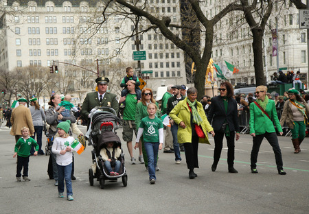 st  patrick s day: NEW YORK - MARCH 17, 2016: Families with young kids marching at the St. Patrick s Day Parade in New York. Editorial