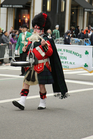 march band: NEW YORK - MARCH 17, 2016: Amityville Highland Pipe Band marching at the St. Patrick s Day Parade in New York. Editorial