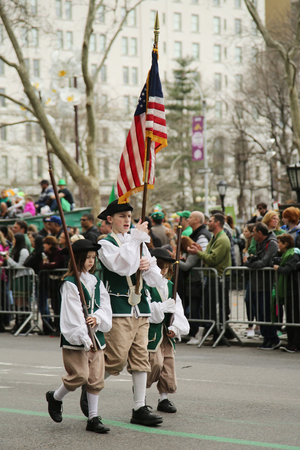 st  patrick s day: NEW YORK - MARCH 17, 2016: The Young Colonials Fyfe and Drum Corps marching at the St. Patrick s Day Parade in New York.