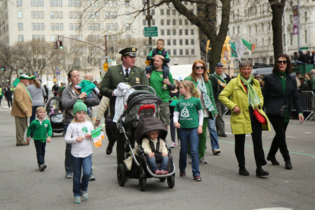 march 17: NEW YORK - MARCH 17, 2016: Families with young kids marching at the St. Patrick s Day Parade in New York. Editorial