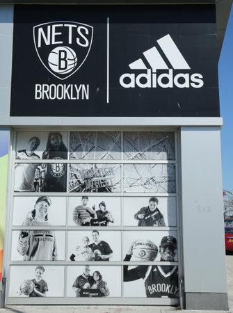 adidas: BROOKLYN, NEW YORK - MARCH 29, 2016 : Nets Lifestyle Shop by Adidas at Coney Island in Brooklyn.The Brooklyn Nets are a professional basketball team based in the New York City borough of Brooklyn Editorial