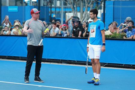boris: MELBOURNE, AUSTRALIA - JANUARY 27, 2016: Six times Grand Slam champion Boris Becker coaching Novak Djokovic for Australian Open 2016 at Australian tennis center in Melbourne Park