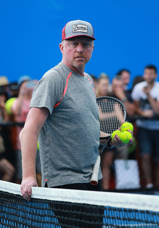 grand slam: MELBOURNE, AUSTRALIA - JANUARY 27, 2016: Six times Grand Slam champion Boris Becker coaching Novak Djokovic for Australian Open 2016 at Australian tennis center in Melbourne Park