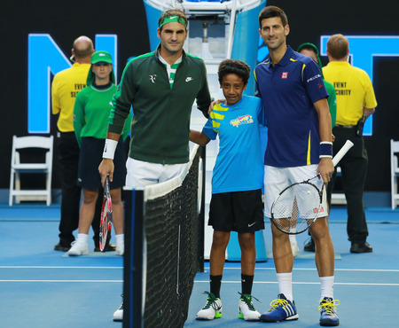 swiss ball: MELBOURNE, AUSTRALIA - JANUARY 28, 2016: Grand Slam champions Roger Federer of Switzerland (L) and Novak Djokovic of Serbia before semifinal match at Australian Open 2016 in Melbourne Park