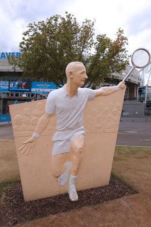 racket stadium: MELBOURNE, AUSTRALIA - JANUARY 28, 2016: Rod Laver Statue in the front of the Rod Laver arena at Australian tennis center in Melbourne Park.
