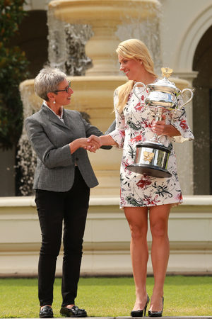 linda: MELBOURNE, AUSTRALIA - JANUARY 31, 2016: Governor of Victoria the Honourable Linda Dessau (L) greeting Australian Open 2016 champion Angelique Kerber of Germany in Government House in Melbourne Editorial