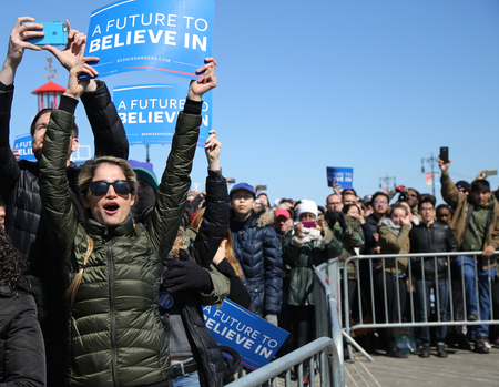 legislator: NEW YORK - APRIL 10, 2016:Bernie Sanders supporter during presidential candidate Bernie Sanders rally  at iconic Coney Island boardwalk in Brooklyn, New York