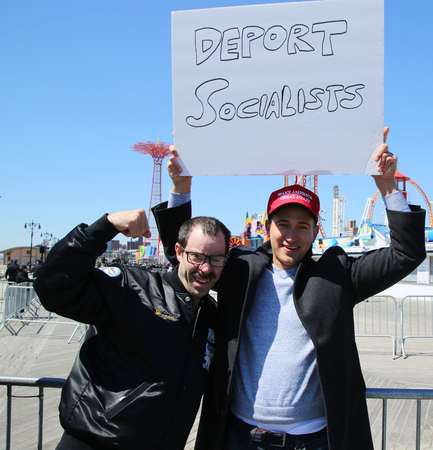 donald: NEW YORK - APRIL 10, 2016: Donald Trump supporters protest against presidential candidate Bernie Sanders during his rally at iconic Coney Island boardwalk in Brooklyn, New York