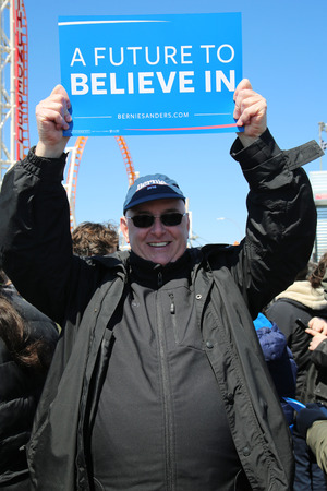 senate elections: NEW YORK - APRIL 10, 2016:Bernie Sanders supporter during presidential candidate Bernie Sanders rally at iconic Coney Island boardwalk in Brooklyn, New York
