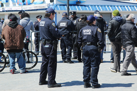 counter terrorism: NEW YORK - APRIL 10, 2016: NYPD counter terrorism officers at iconic Coney Island boardwalk during presidential candidate Bernie Sanders rally in Brooklyn, New York