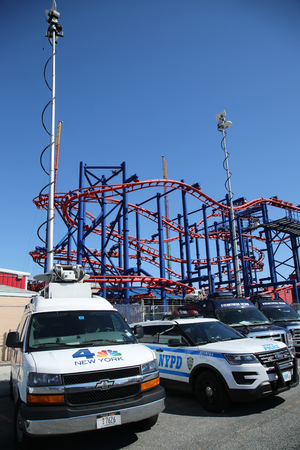 NEW YORK - APRIL 10, 2016: Numerous TV stations covers presidential candidate Bernie Sanders rally at iconic Coney Island boardwalk in Brooklyn, New York Editorial