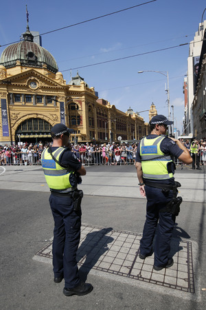 constable: MELBOURNE, AUSTRALIA - JANUARY 25, 2016: Victoria Police Constable providing security during Australia Day Parade in Melbourne Editorial