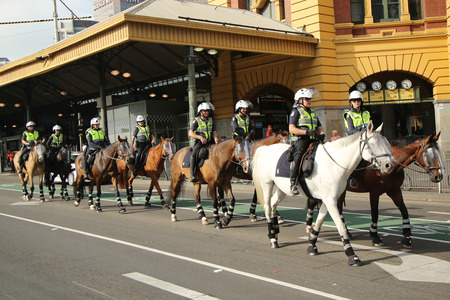 constable: MELBOURNE, AUSTRALIA - JANUARY 25, 2016: Victorian Police Mounted Branch Constables providing security during Australia Day Parade in Melbourne Editorial