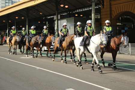 constabulary: MELBOURNE, AUSTRALIA - JANUARY 25, 2016: Victorian Police Mounted Branch Constables providing security during Australia Day Parade in Melbourne Editorial
