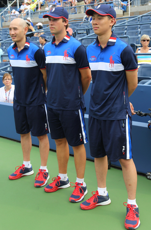 center court: NEW YORK - AUGUST 31, 2015: Ball boys on tennis court during US Open 2015 at the Billie Jean King National Tennis Center in Flushing, NY Editorial