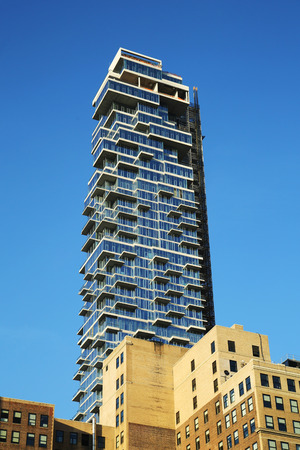 gentrification: NEW YORK - APRIL 17, 2016: Nearly completed 60-story building a k a the Jenga Tower at 56 Leonard Street in Tribeca, Lower Manhattan. Editorial