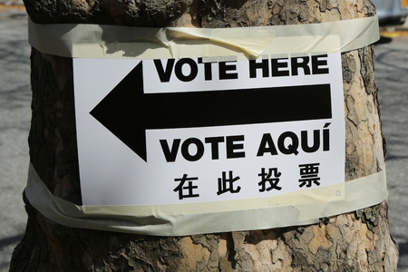 prohibits: NEW YORK - APRIL 19, 2016: Sign at the voting site in New York.The Voting Rights Act of 1965 is a national legislation in the United States that prohibits discrimination in voting Editorial