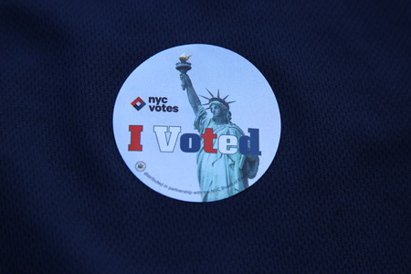 voted: NEW YORK - APRIL 19, 2016: I voted in New York sticker in New York.The Voting Rights Act of 1965 is a national legislation in the United States that prohibits discrimination in voting