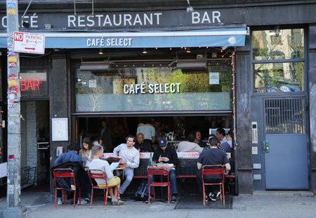 NEW YORK - APRIL 24, 2016: Busy street cafe in Soho in New York City
