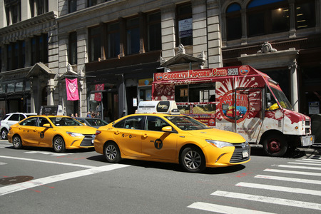 NEW YORK CITY - APRIL 24, 2016: New York City Taxi in Soho. New York City has around 6,000 hybrid taxis, representing almost 45 of the taxis in service, the most in any city in North America 報道画像