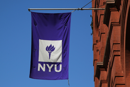 public service: NEW YORK - APRIL 24, 2016: NYU flag on historic Puck Building at Wagner Graduate School of Public Service in Lower Manhattan