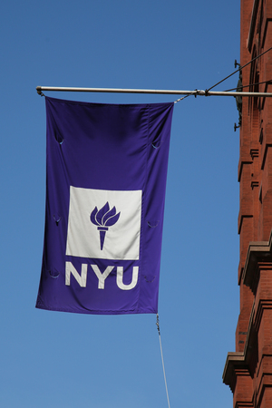 NEW YORK - APRIL 24, 2016: NYU flag on historic Puck Building at Wagner Graduate School of Public Service in Lower Manhattan