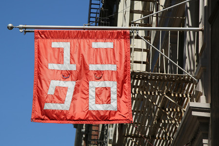 NEW YORK - APRIL 24, 2016: UNIQLO logo sign located in Manhattan s chic Soho neighborhood. Uniqlo is a Japanese casual wear designer, manufacturer and retailer Sajtókép