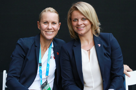 grand slam: MELBOURNE, AUSTRALIA - JANUARY 28, 2016: Channel 7 analysts Grand Slam champions Rennae Stubbs (L) and Kim Clijsters during Australian Open 2016 match at Rod Laver Arena in Melbourne Park