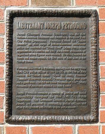organized crime: NEW YORK - APRIL 24, 2016: Lieutenant Joseph Petrosino memorial plaque in Lower Manhattan. Joseph Petrosino was a New York City police officer who was a pioneer in the fight against organized crime. Editorial