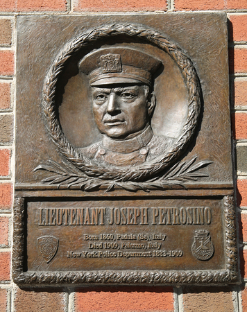 new world order: NEW YORK - APRIL 24, 2016: Lieutenant Joseph Petrosino memorial plaque in Lower Manhattan. Joseph Petrosino was a New York City police officer who was a pioneer in the fight against organized crime. Editorial