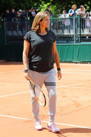supervise: PARIS, FRANCE- MAY 25, 2015: Pregnant tennis coach and two times Grand Slam Champion Amelie Mauresmo supervise Andy Murray practice at Roland Garros 2015 in Paris, France Editorial
